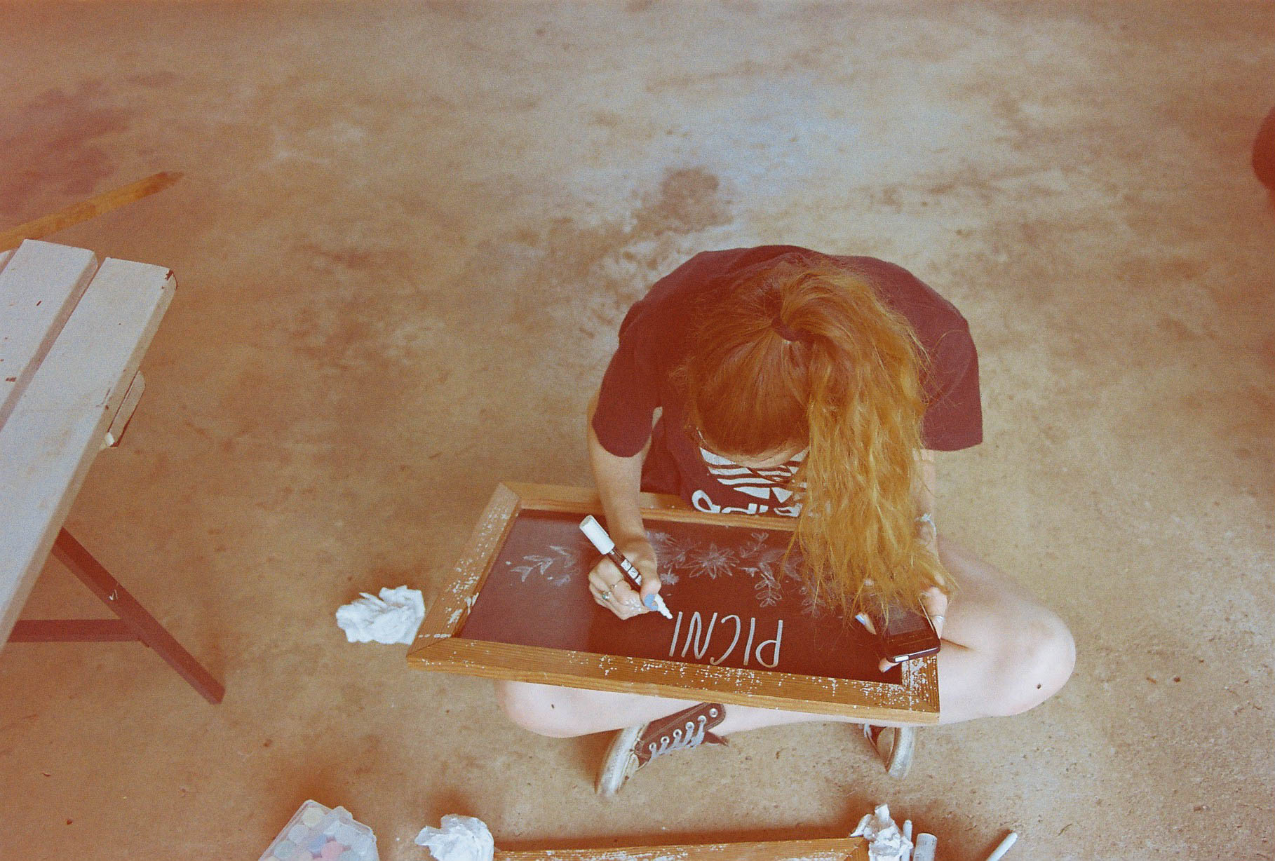 A photo of Abi Gifford Designer preparing a board for a wedding ceremony in Bridgetown, Western Australia
