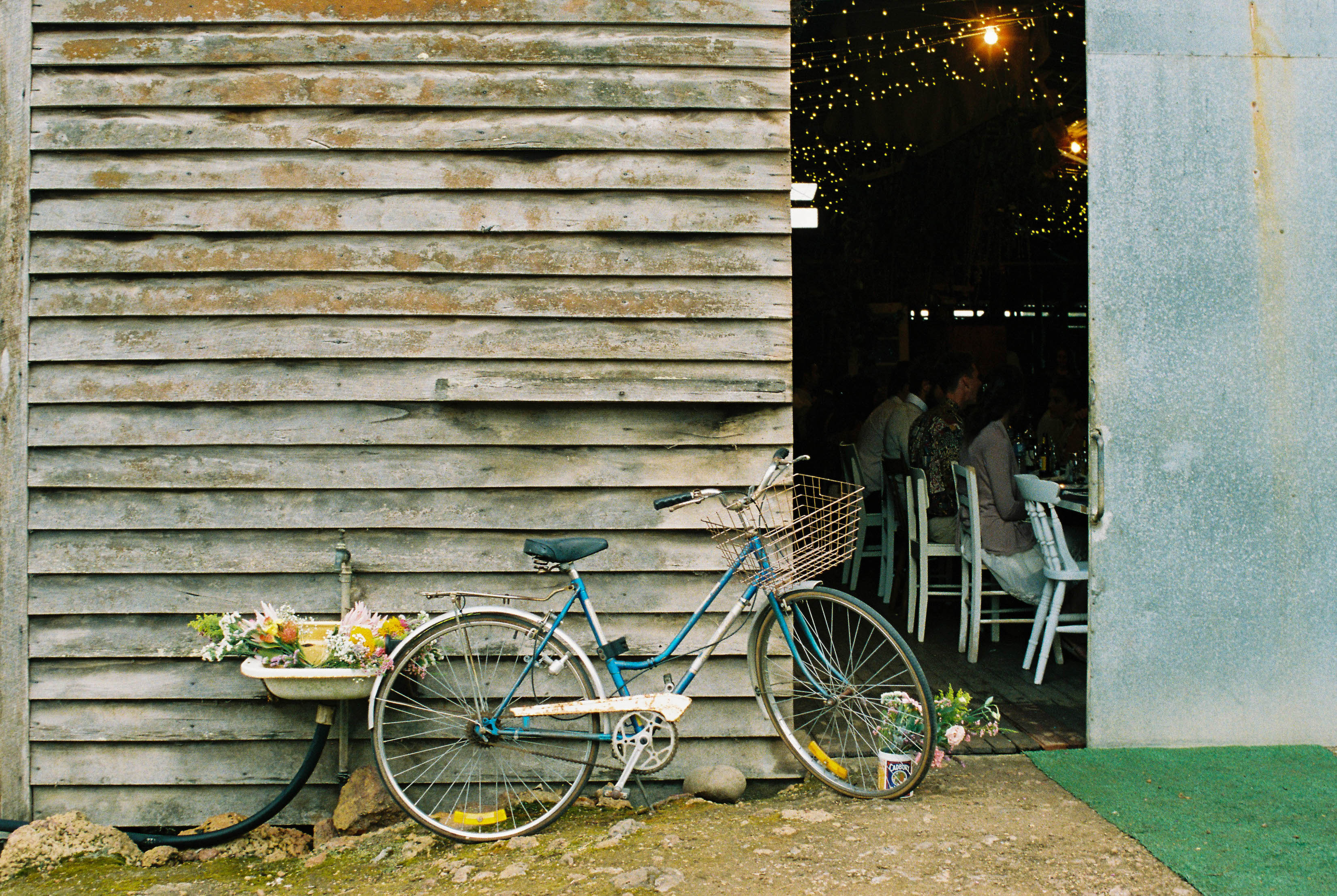 A photograph of an old bike out the front of a wedding reception