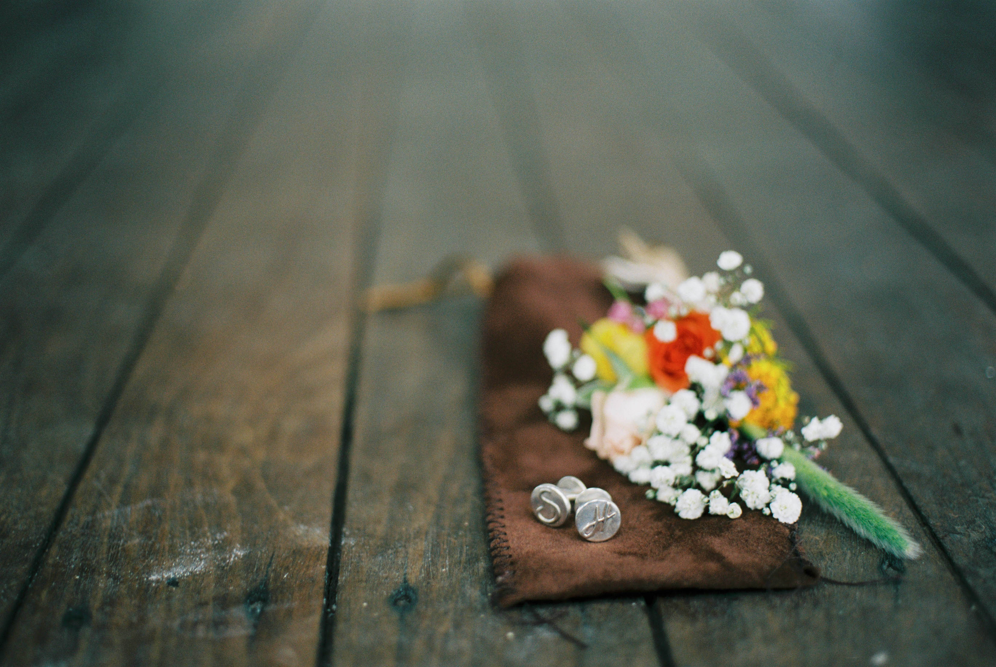 A photo of the groom's handmade cuff links taken on 35mm film