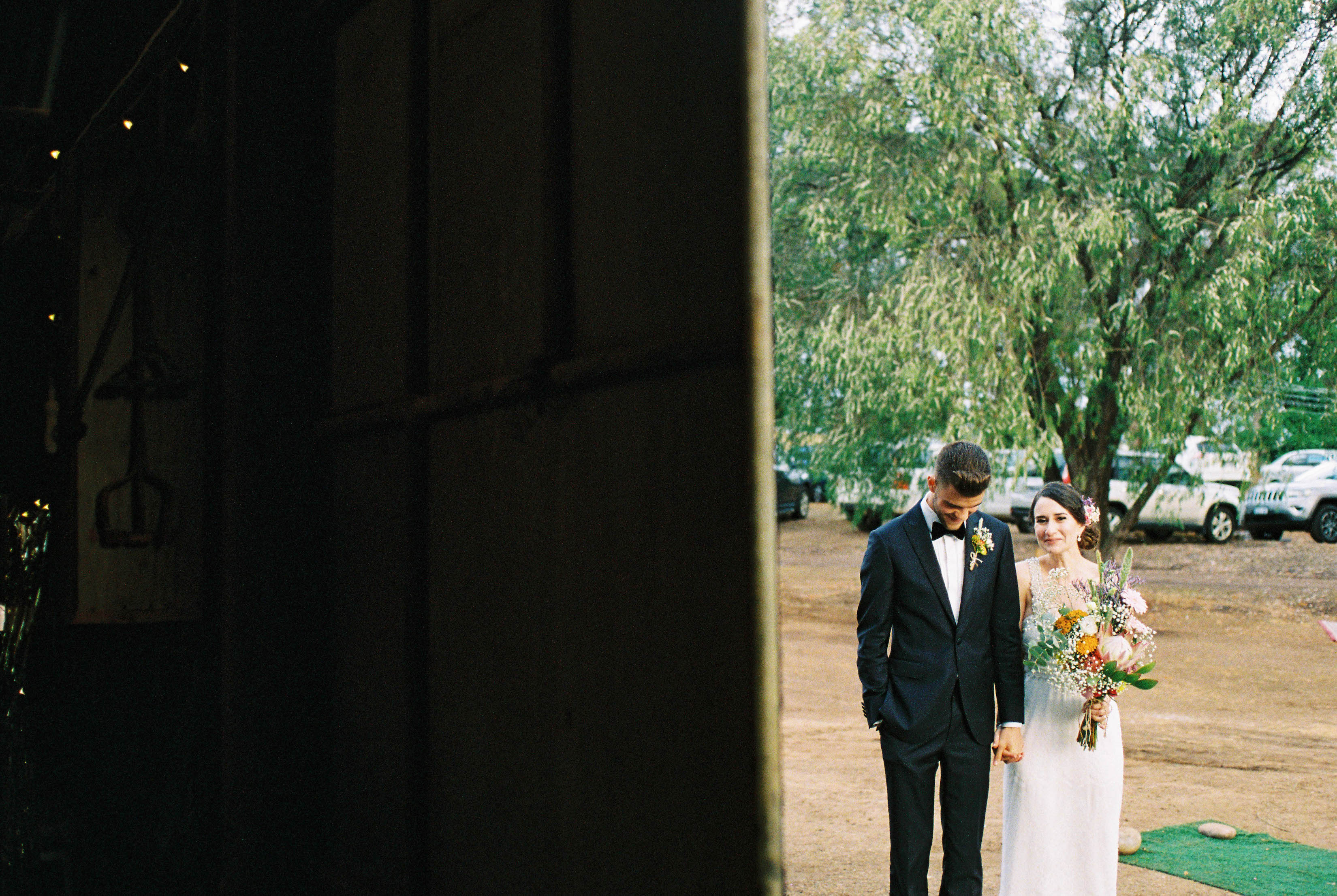 A wedding photo of the bride & groom waiting for their introduction at their Farm Wedding Reception