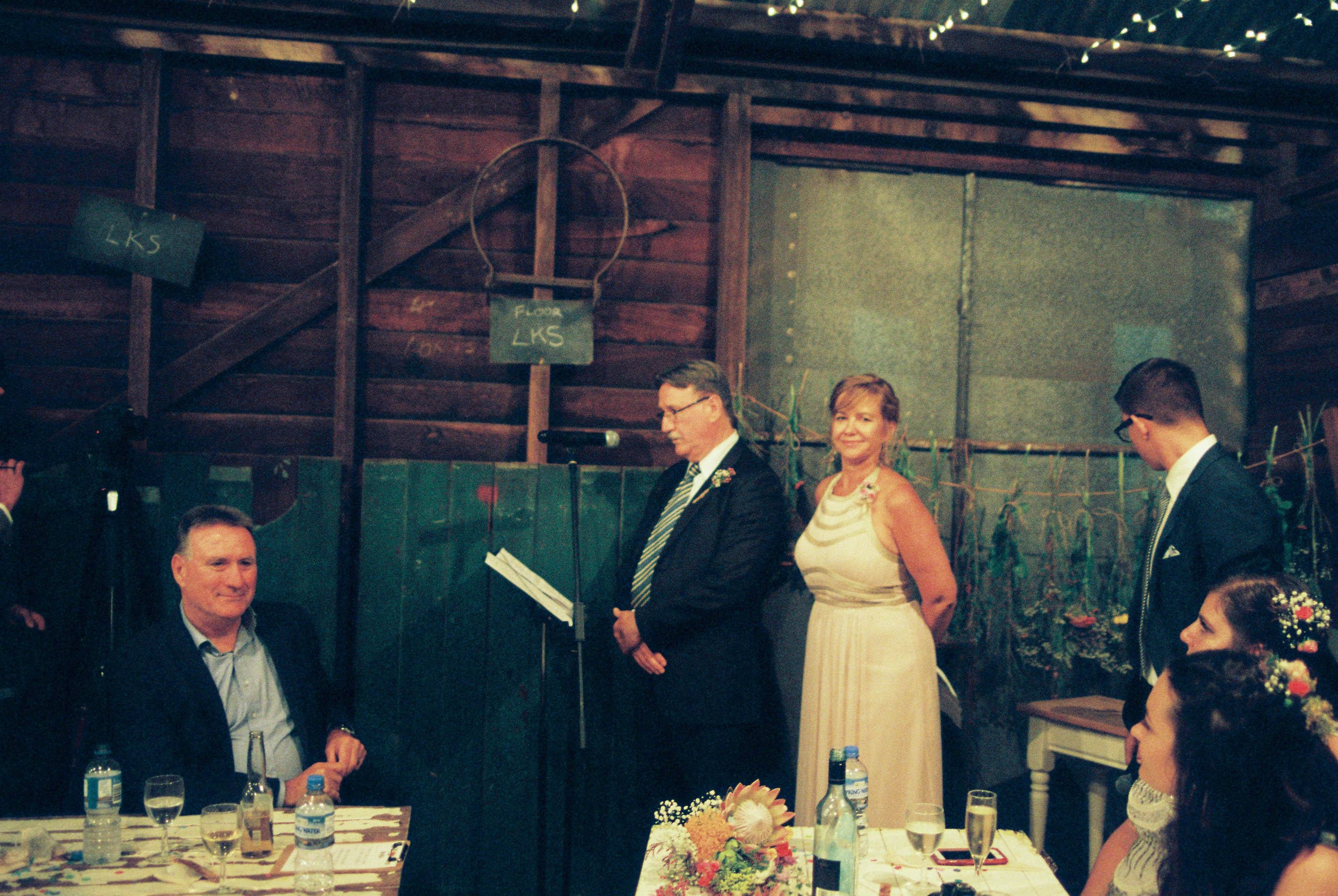 Documentary Wedding Photography of the Bride's Parents during their speech