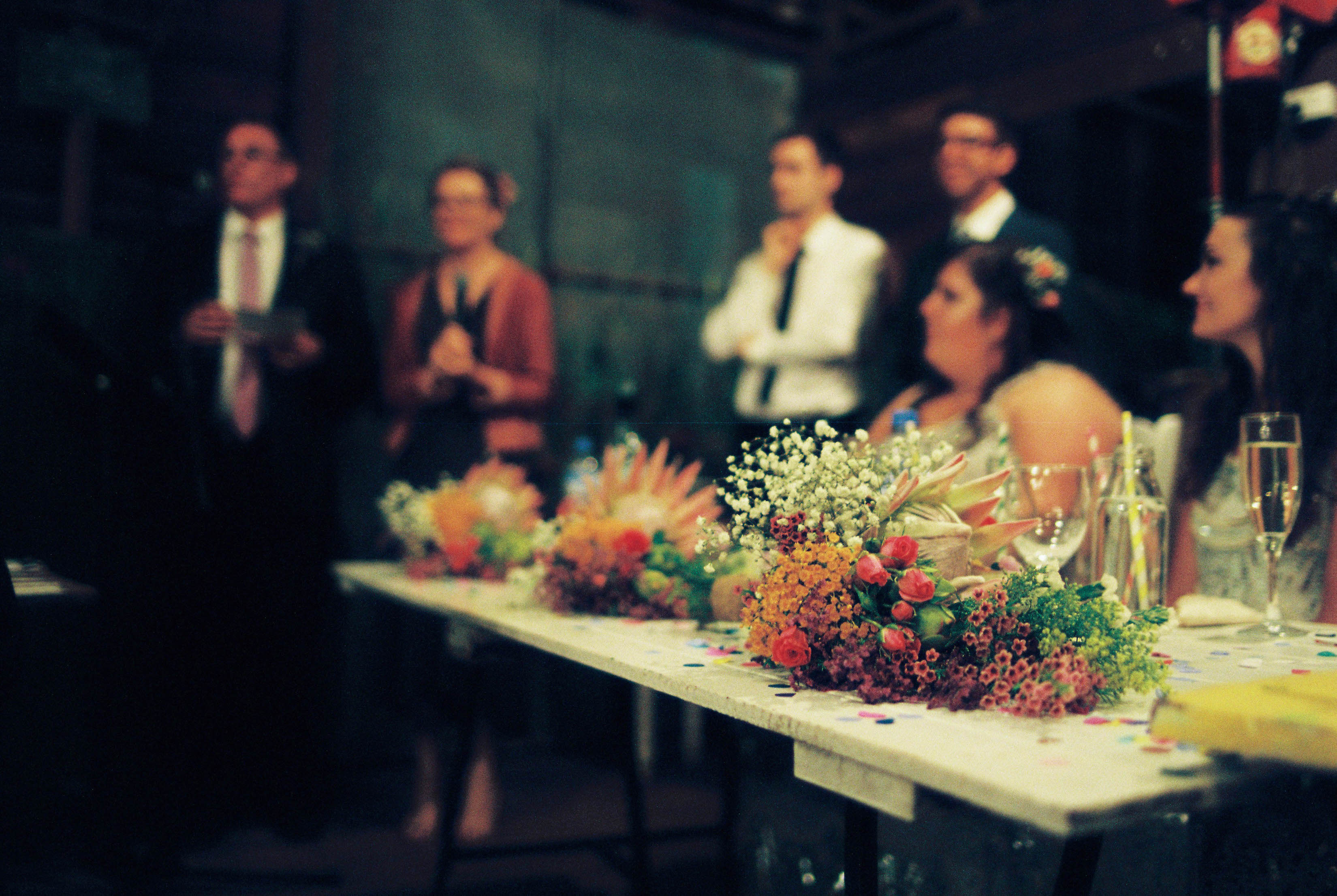 An analogue photo of the bride's and bridesmaid's bouquets at a Bridgetown Wedding Reception