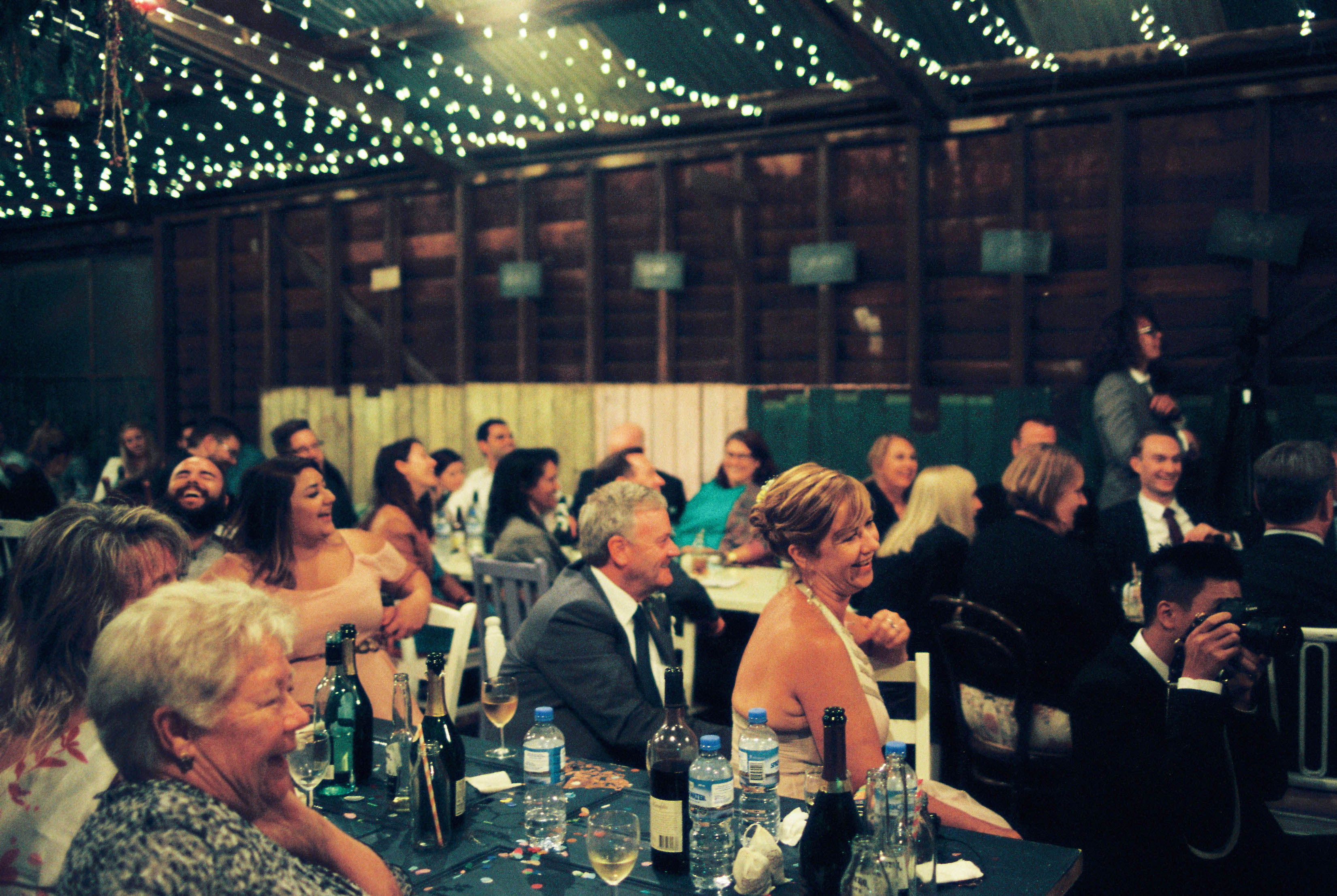 A candid photo of guests looking on during the speeches at a Shearing Shed Wedding Reception