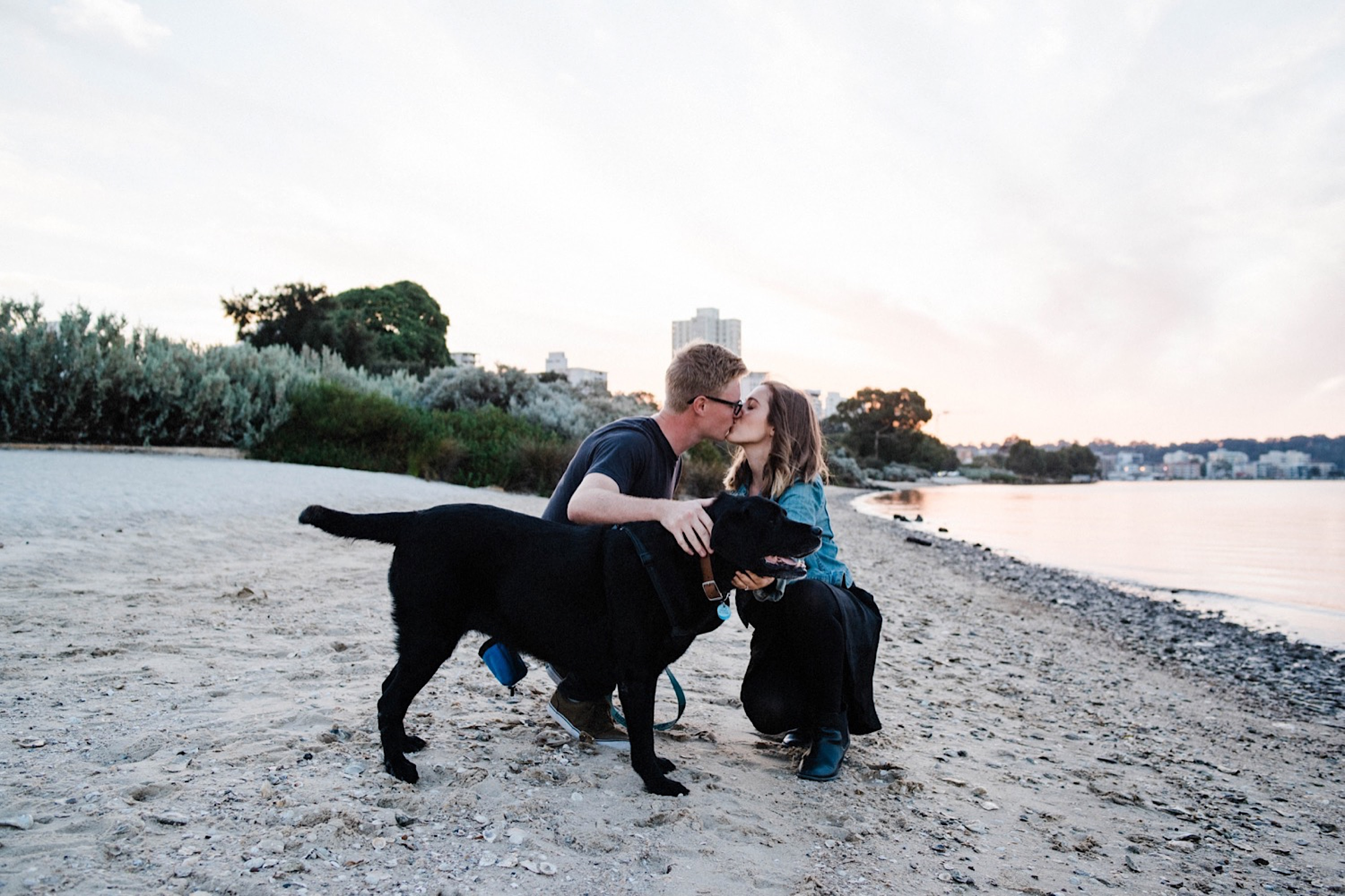 A family photo of a couple with their dog, an old black Labrador, at Sir James Mitchell Park, Perth.