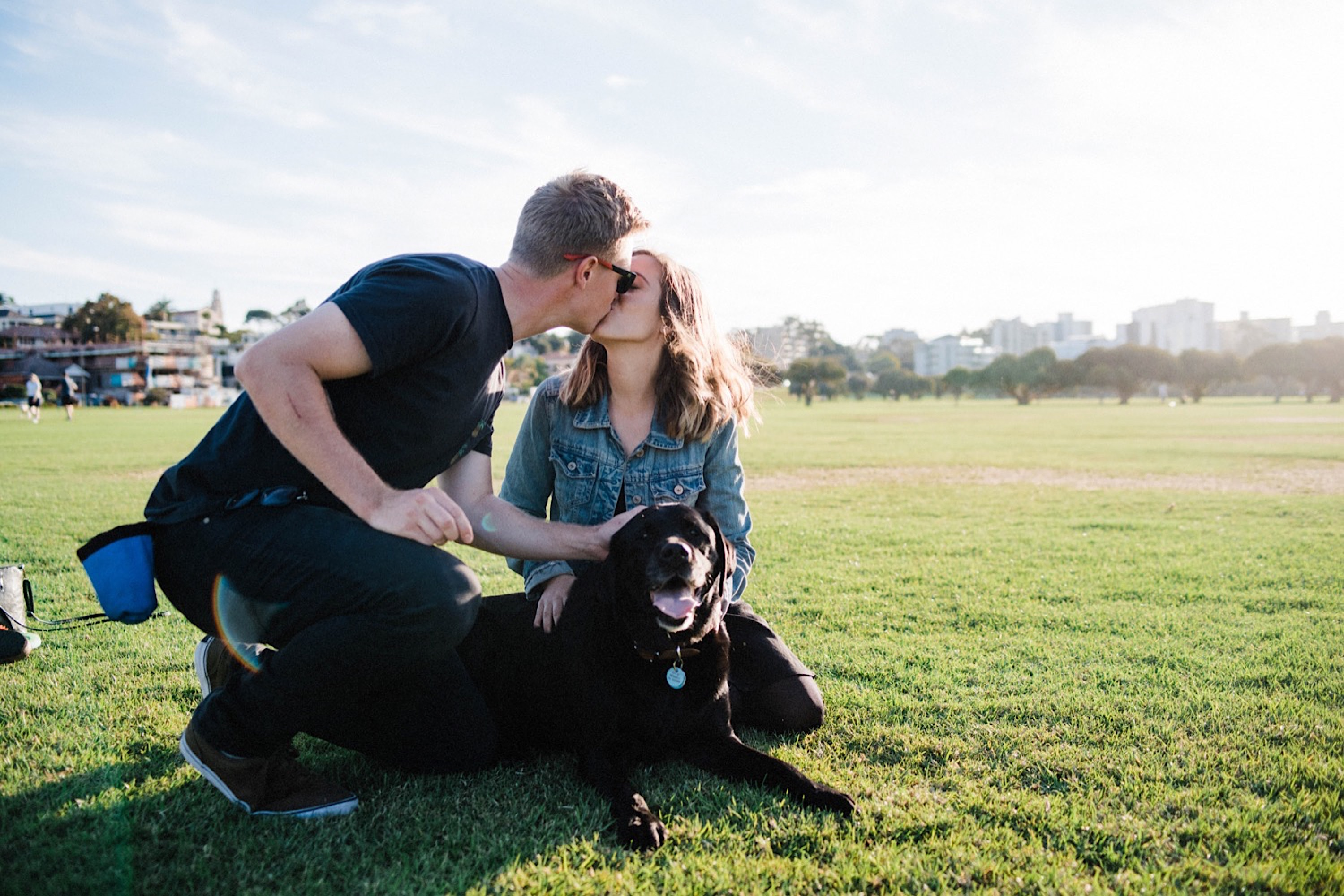 Photos of a couple with their dog, kneeling on the grass, at Sir James Mitchell Park, South Perth.
