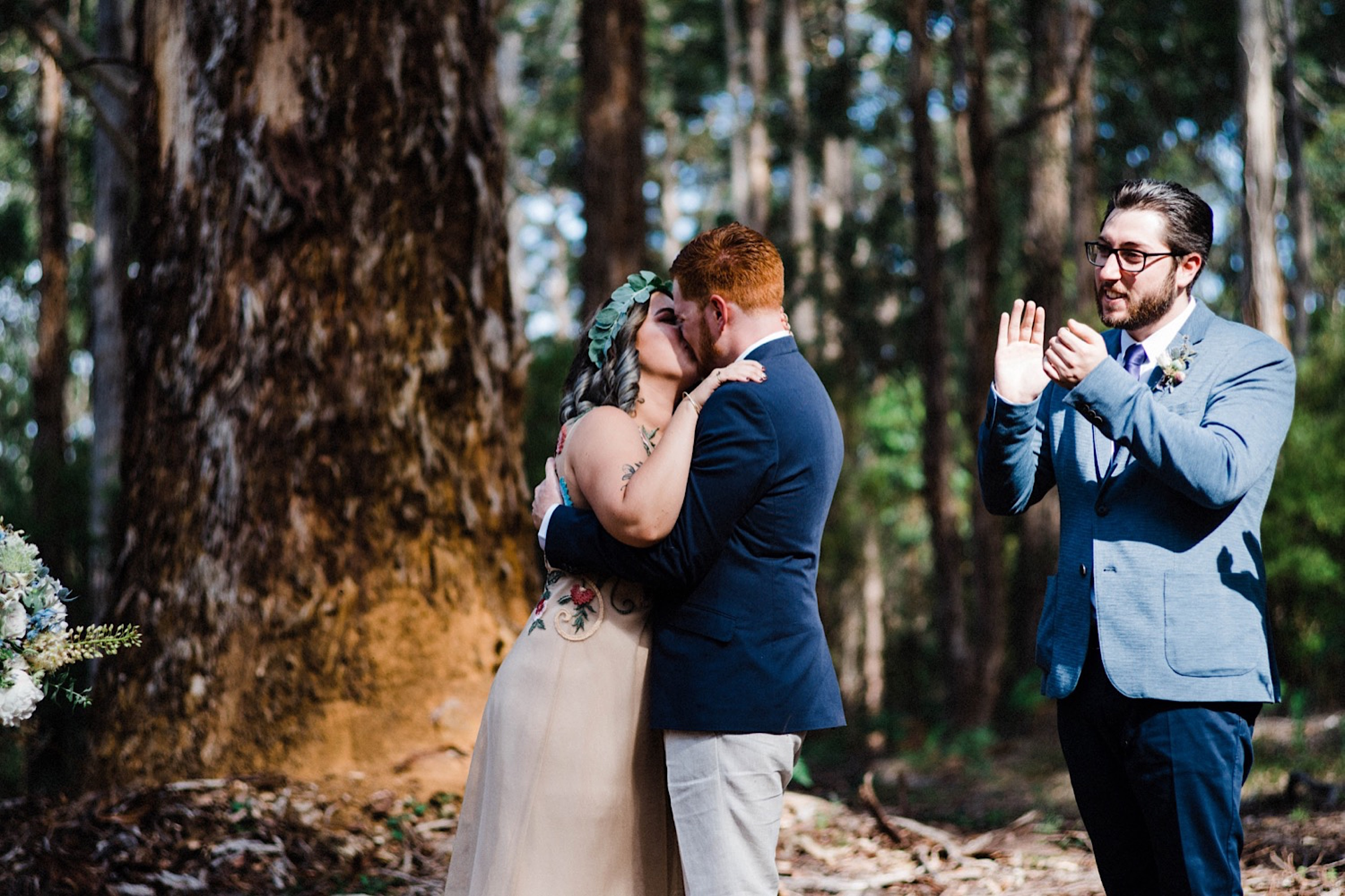 A documentary wedding photo of the bride & groom's first kiss at their Donnelly River Wedding.