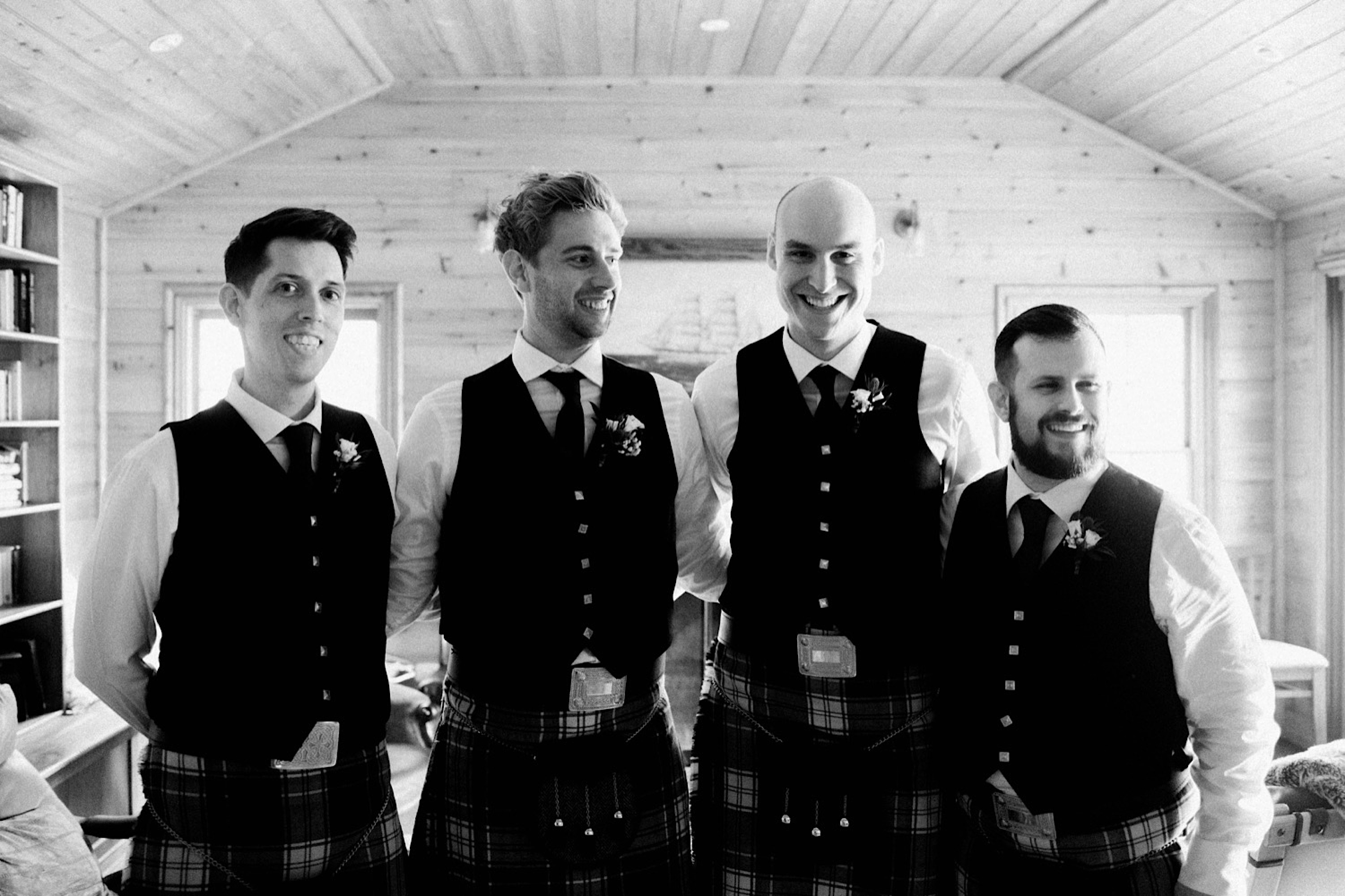 A black & white wedding portrait of the groom and his groomsmen on the morning of his wedding.
