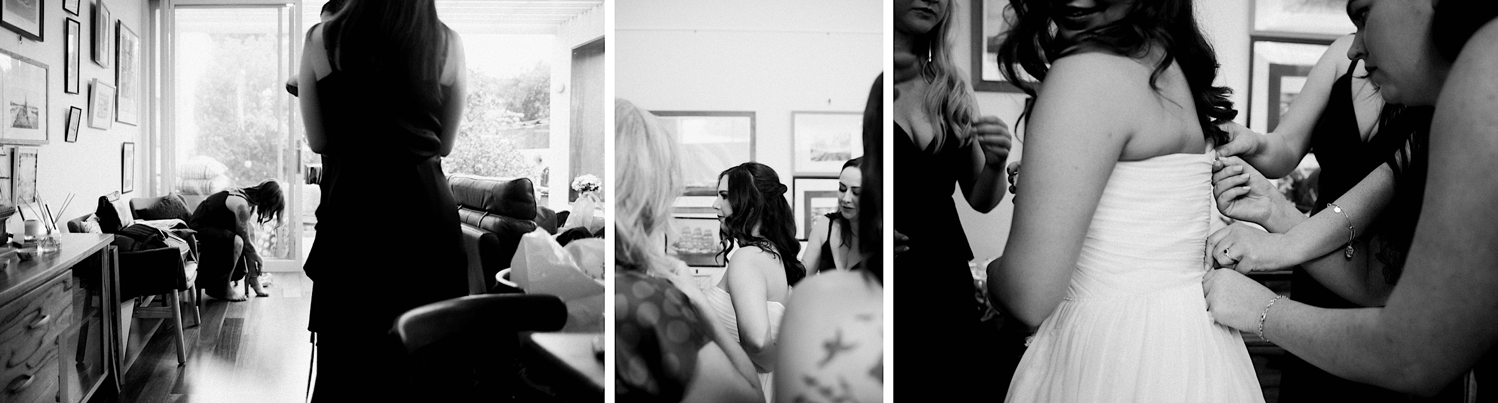 Three black & white documentary wedding photos of the bride getting dress with the help of her bridesmaids.