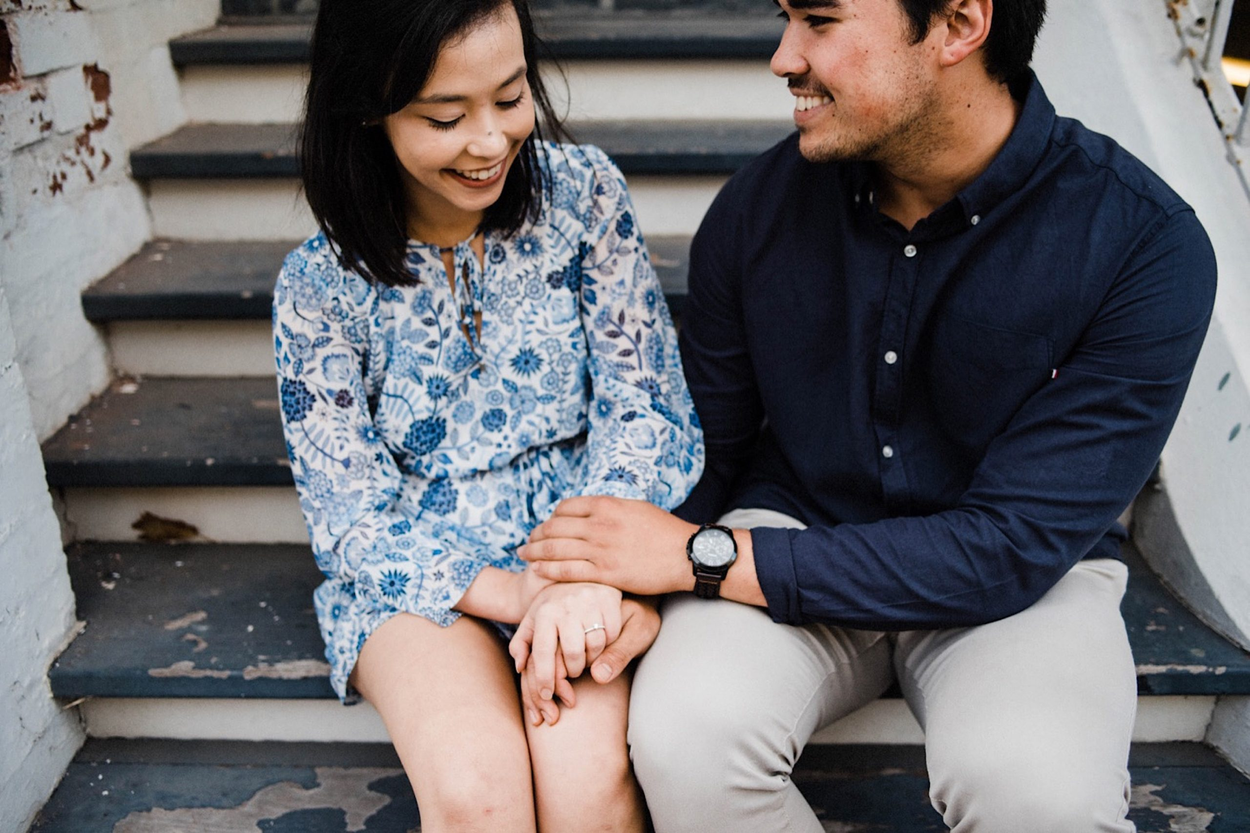 A close-up, romantic engagement portrait of a couple in Fremantle, Australia.