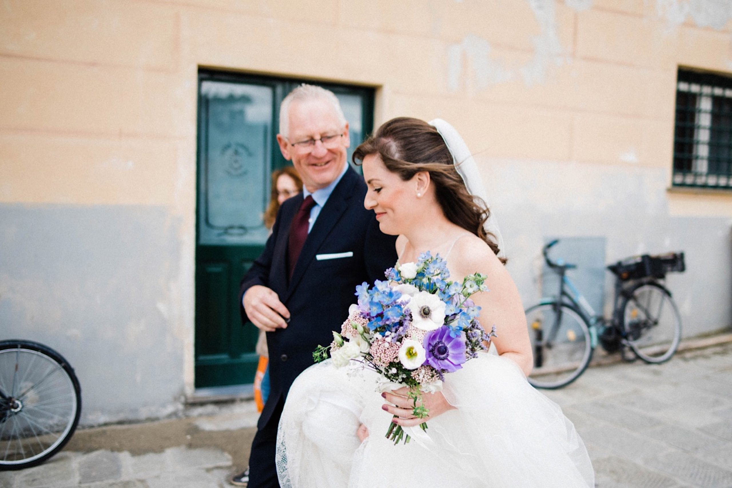 Candid Destination Wedding Photography of the bride & her Dad walking towards her Italian Riviera Wedding Ceremony.