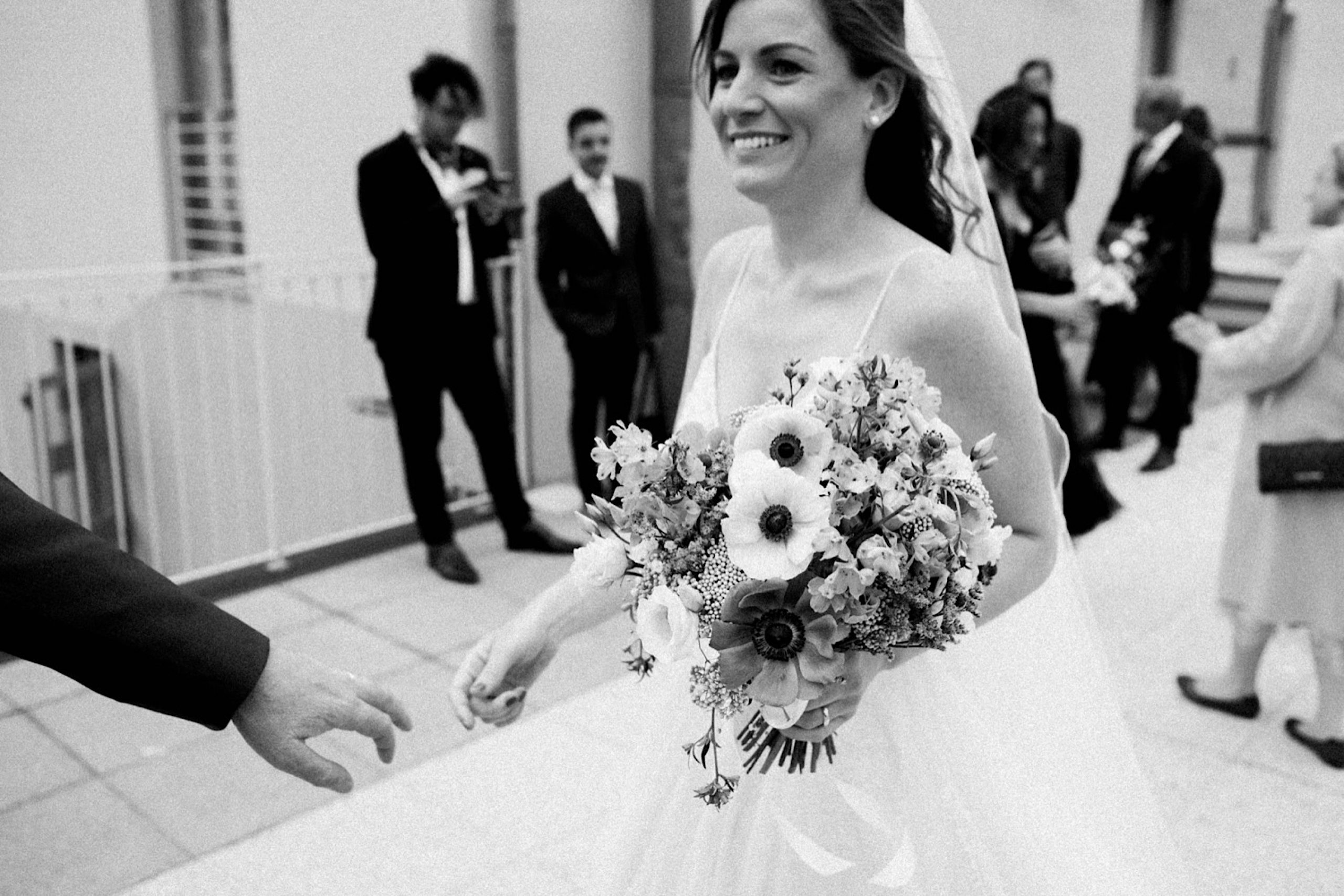 Candid black & white Destination Wedding Photography of the bride leaving her ceremony at the ex-Convento dell'Annunziata.