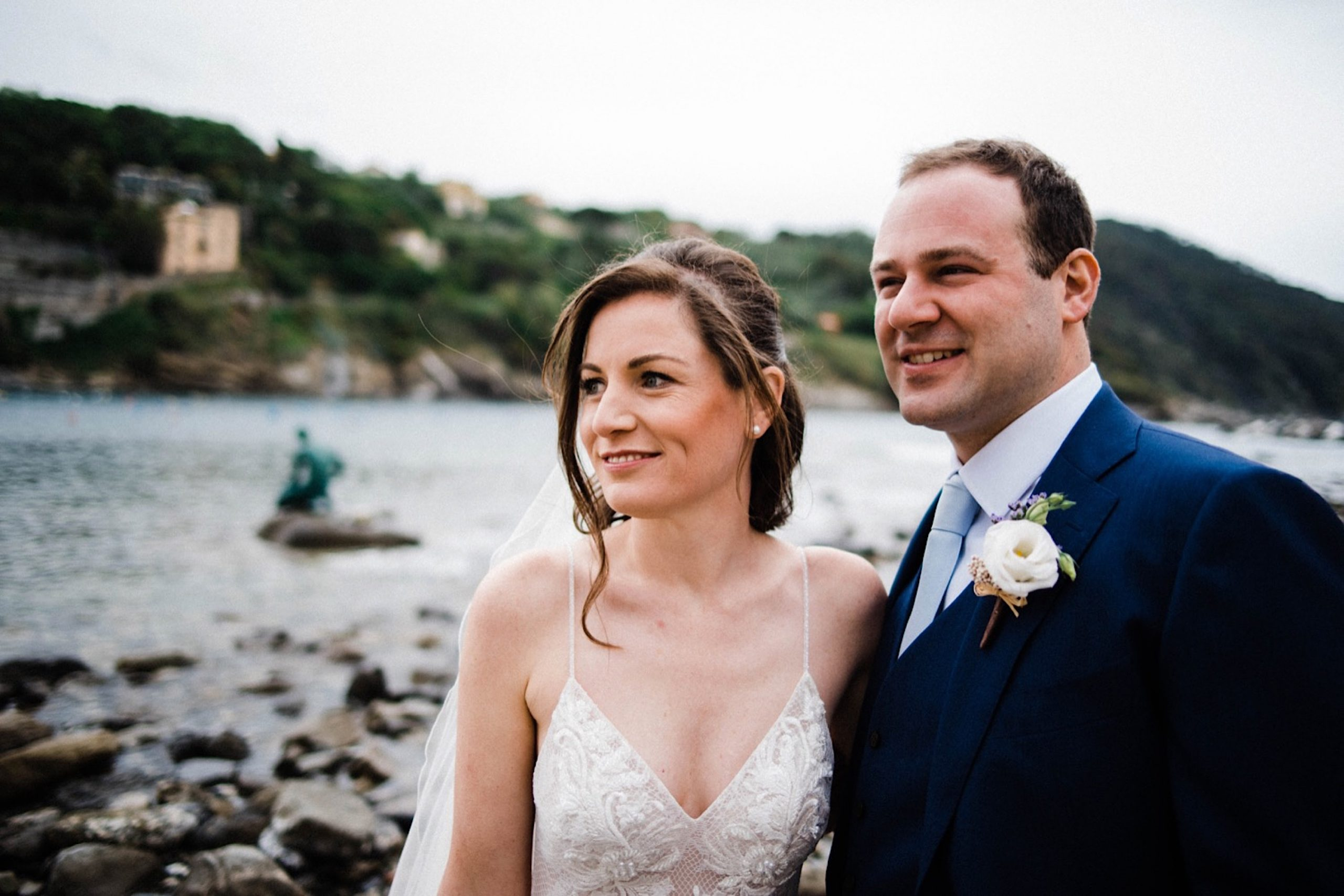 Relaxed Wedding Photography of a bride & groom smiling and looking off to the side in Sestri Levante.