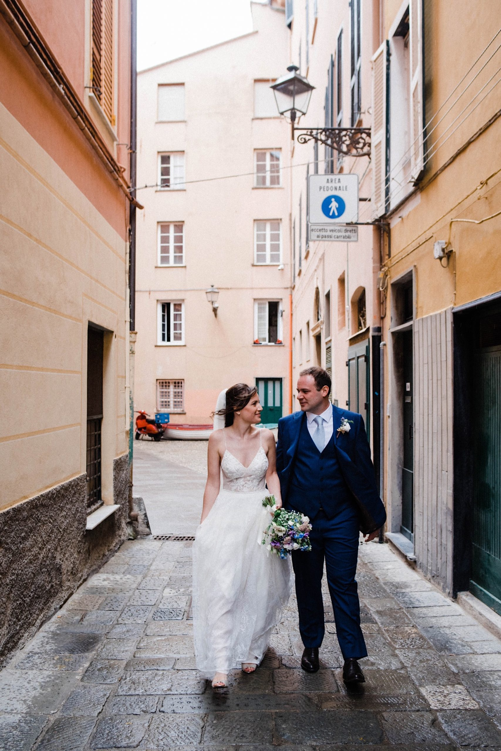 Italian Riviera Destination Photography of the bride & groom walking down the street together in Sestri Levante.