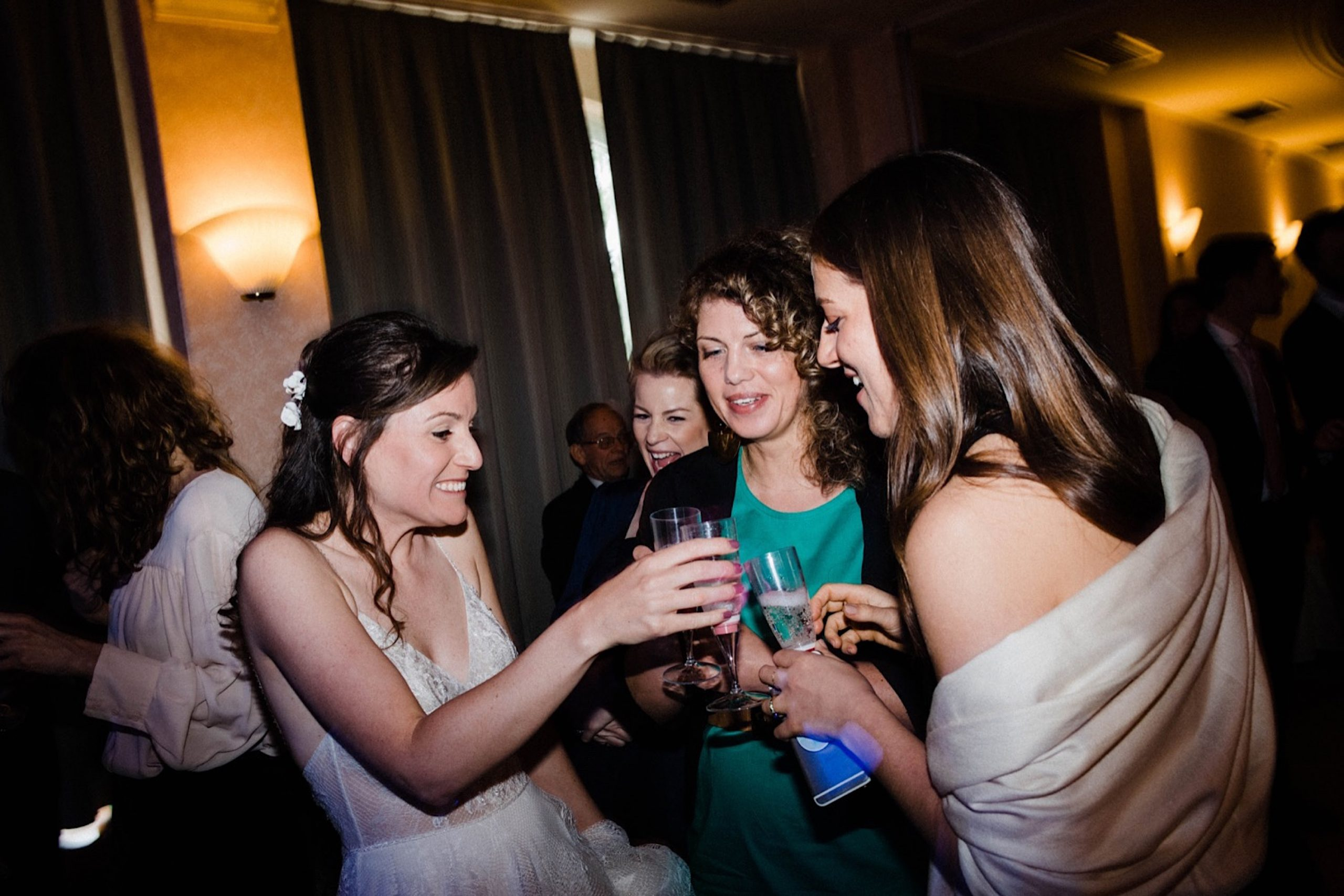 Dance Floor Wedding Photography of the Bride 'cheers-ing' her drink with some of her guests in Sestri Levante.