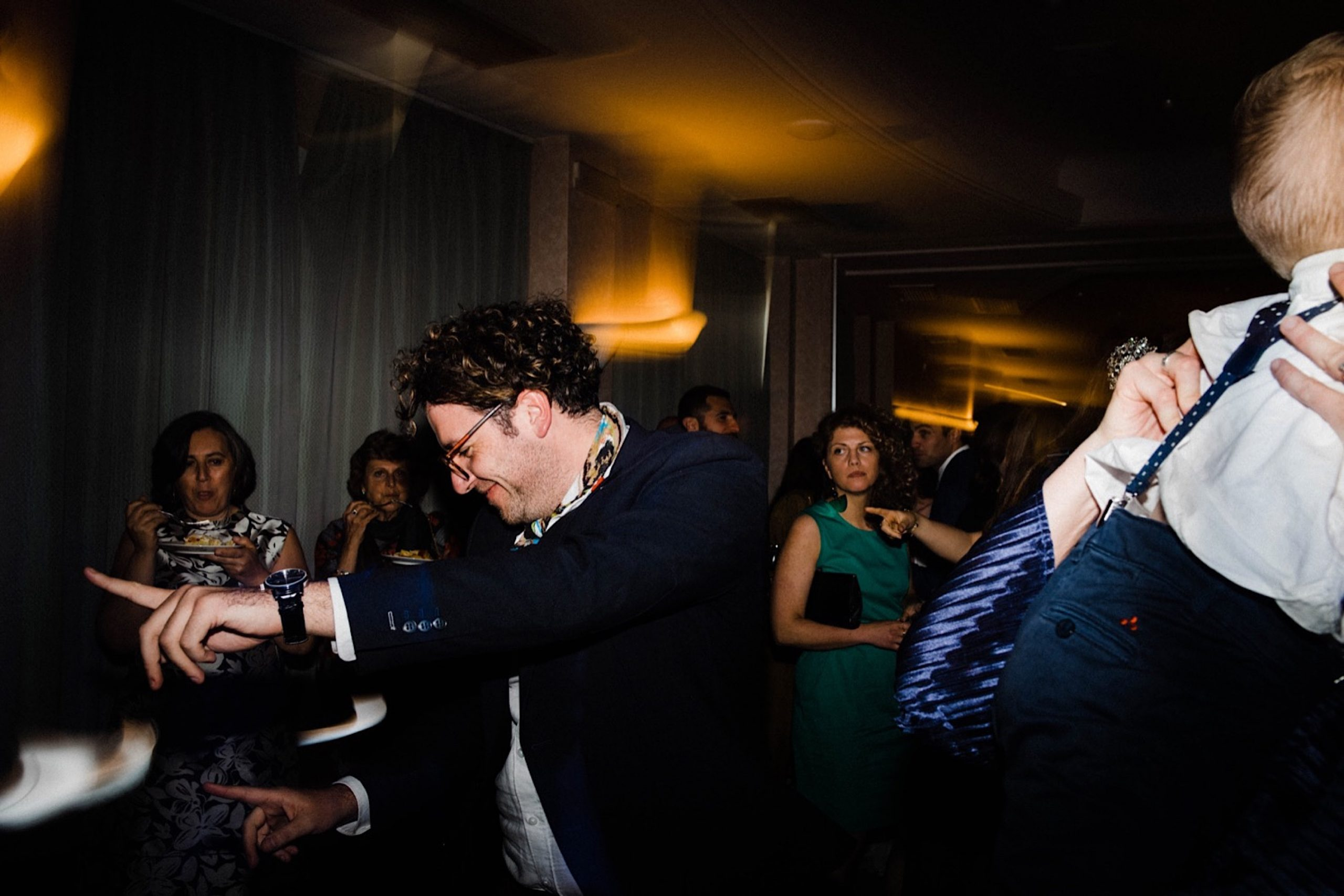 Documentary Wedding Photography of guests dancing at a Sestri Levante Wedding.