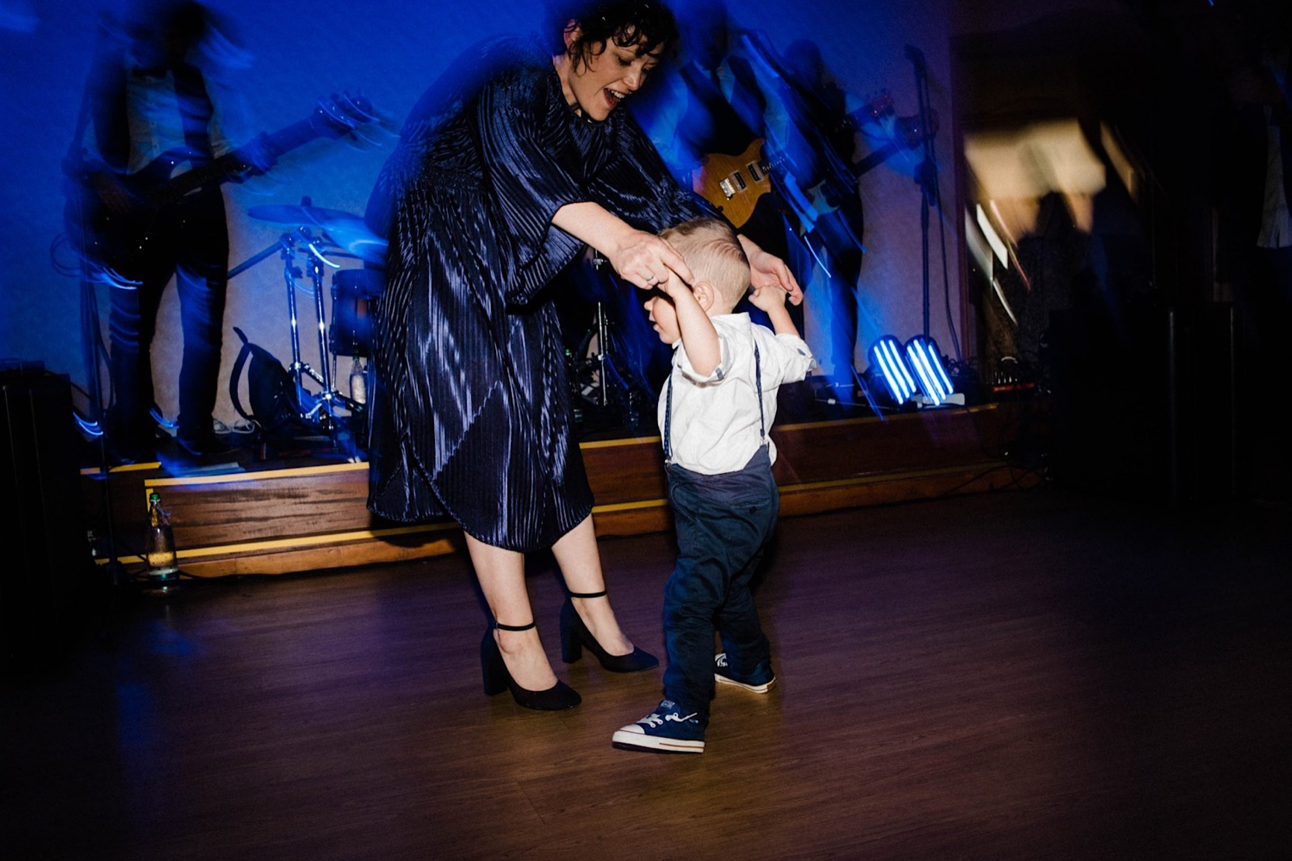 A photo of the bride's sister and her son dancing at a Destination Wedding in Sestri Levante.