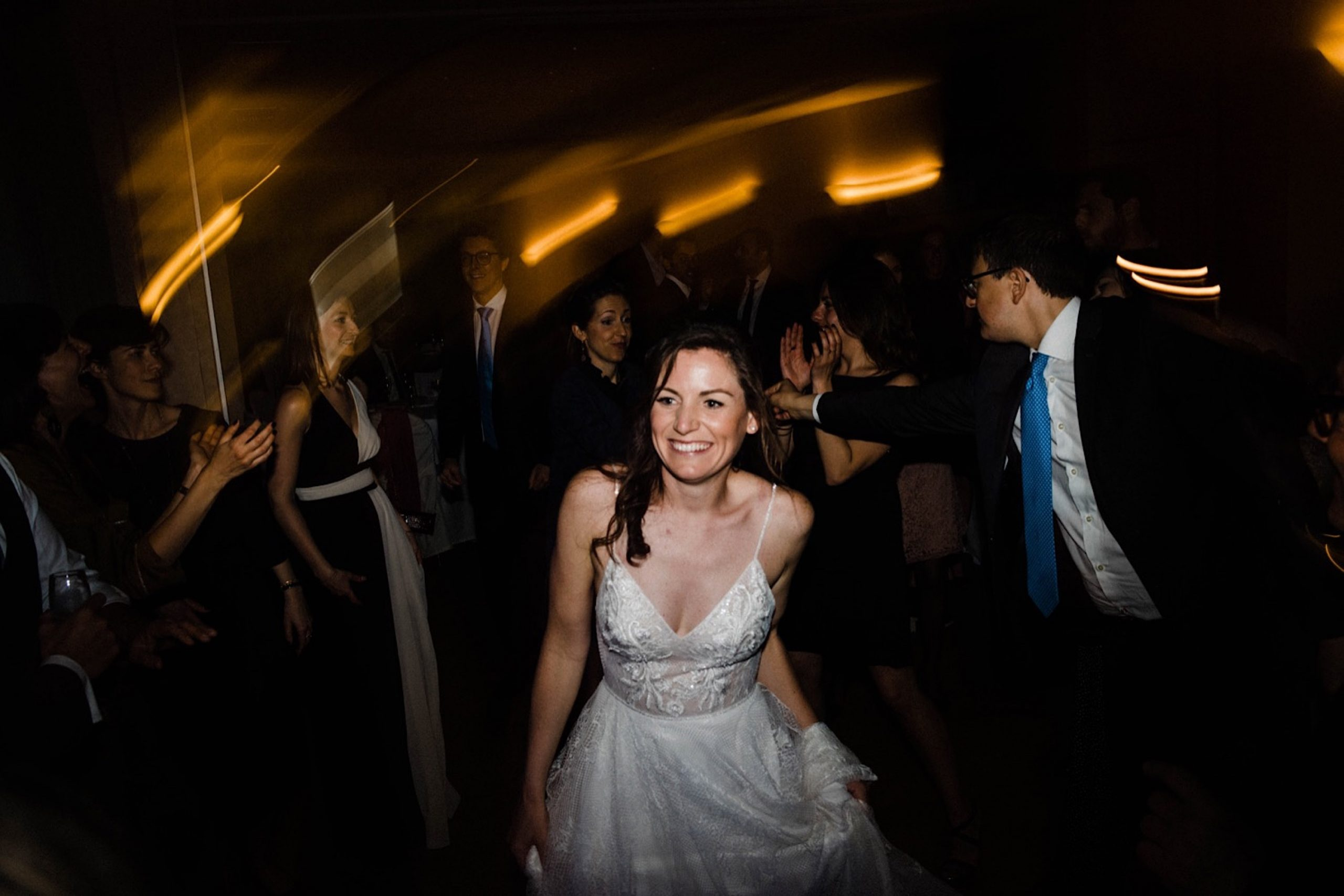 A photo of the bride smiling and dancing at her Italian Destination Wedding.