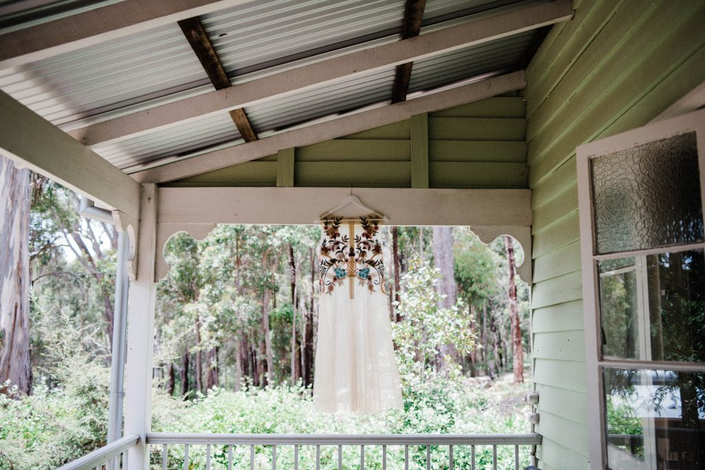 A sheer, embroidered dress made sustainably by Harriette Gordon taken at Donnelly River.