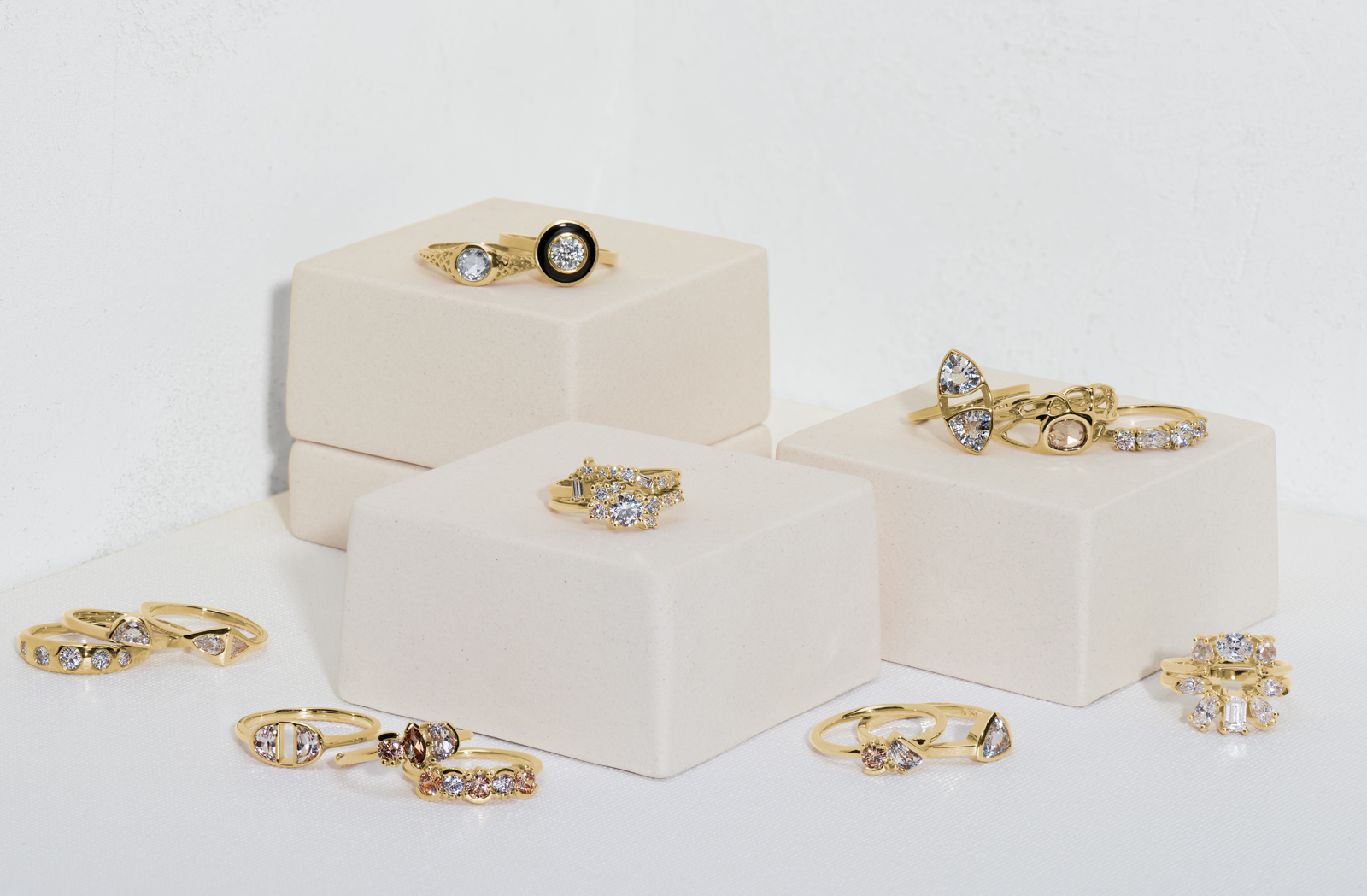 Sustainable Wedding and Engagement Rings by Bario Neal stacked on boxes against a white background.