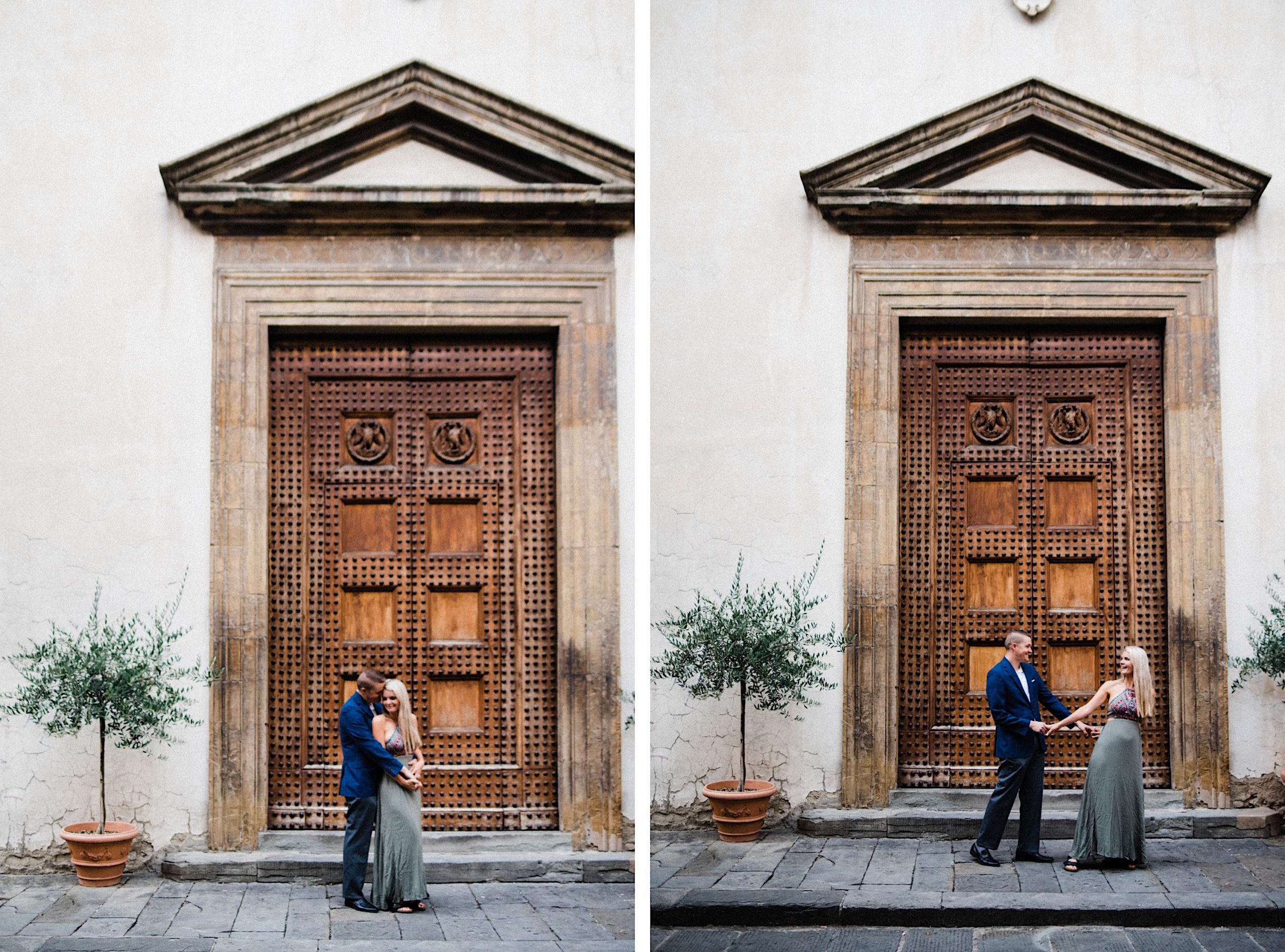 Florence Anniversary Photography of a couple standing in front of an epic, imposing wooden door, with olive trees on either side, in the back streets of Florence.