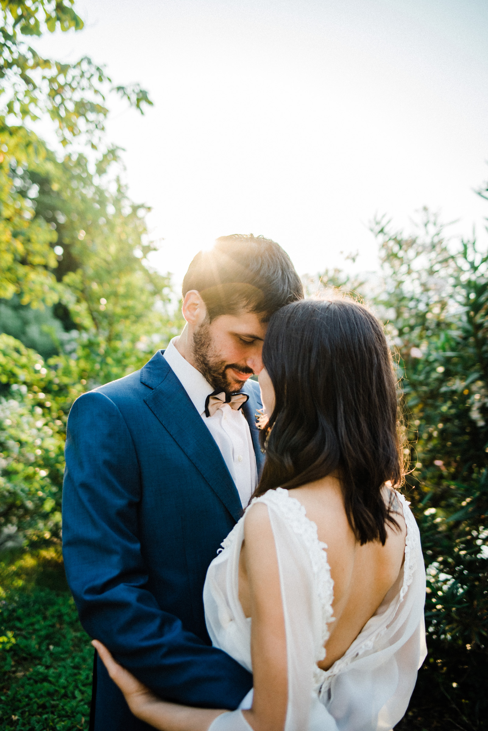 Work of an Authentic and Warm Italian Wedding Photographer, featuring a couple standing together, touching foreheads, during their Bohemian Italian Elopement