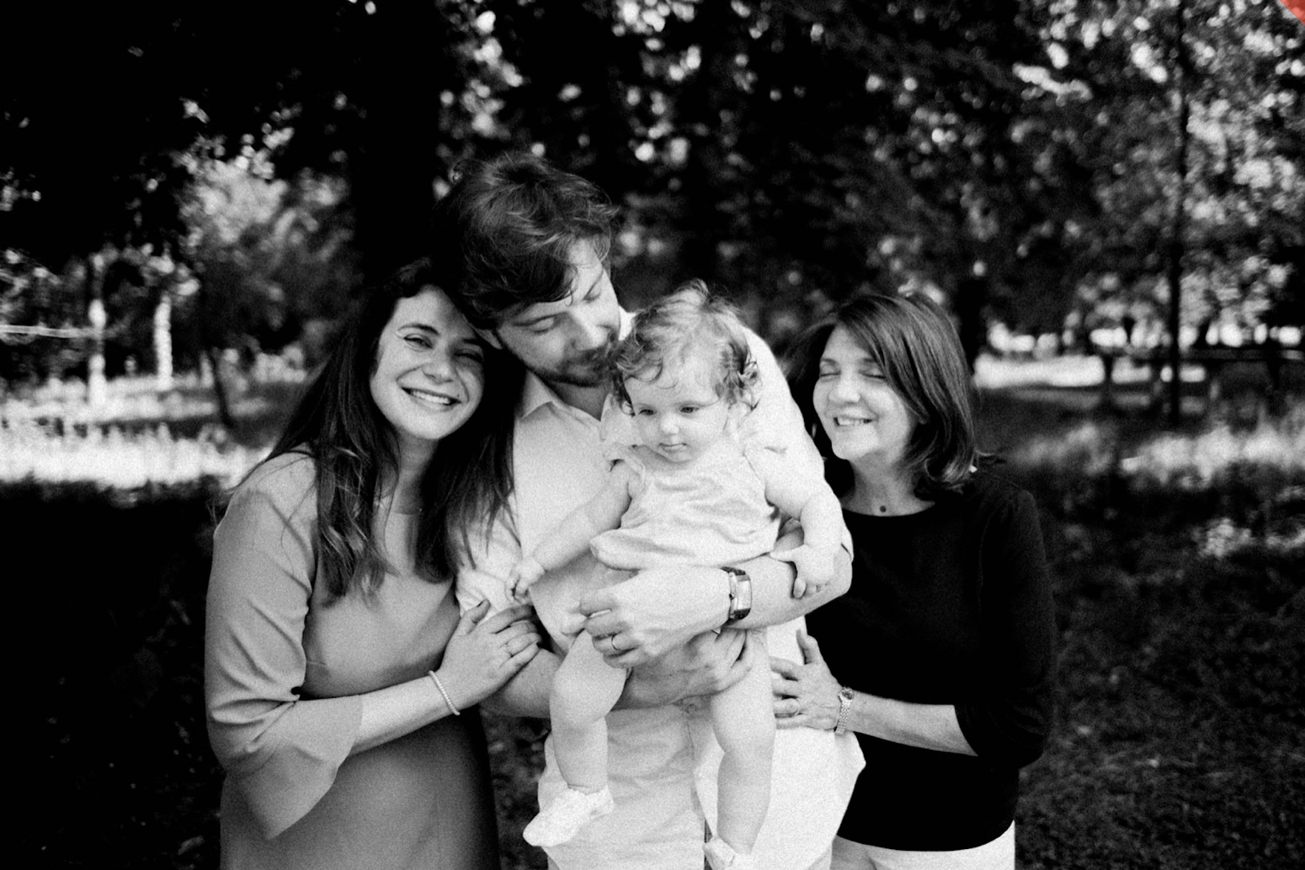 Relaxed Family Portraits of a family - Mum, Dad, Nonna and baby - standing together in the Parco di Monza.